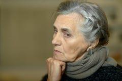 Thoughtful elderly woman Royalty Free Stock Photo