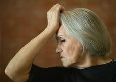 Thoughtful elderly woman Stock Image