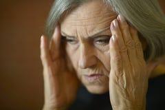 Thoughtful elderly woman Royalty Free Stock Image