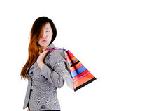 Thoughtful elegant Asian woman. With colorful shopping bags Stock Photos