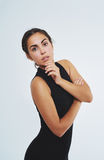 Thoughtful elegant young woman in black Stock Images