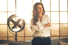 Thoughtful elegant young woman in loft apartment Royalty Free Stock Photo