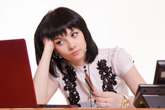 Thoughtful employee call-center front of monitor leaned her head on Stock Images