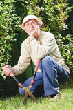 Thoughtful farmer in garden Stock Photo