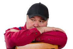 Thoughtful farmer or worker leaning on a chair Stock Photography