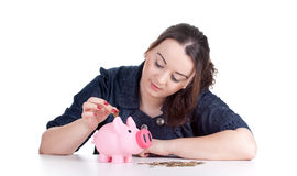 Thoughtful fat girl with piggy bank Royalty Free Stock Image
