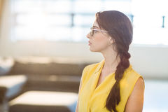 Thoughtful female business executive standing Stock Photography