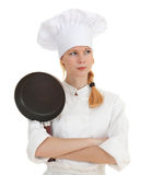 Thoughtful female cook keeping frying pan Royalty Free Stock Photo
