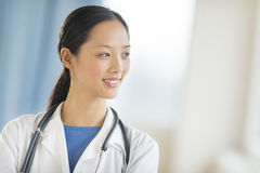 Thoughtful Female Doctor Looking Away Stock Image
