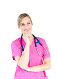 Thoughtful female doctor smiling at the camera Royalty Free Stock Image