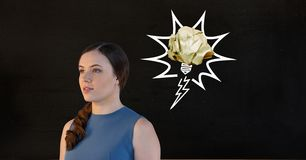 Thoughtful female executive standing against black background Royalty Free Stock Images