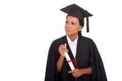 Thoughtful female graduate Royalty Free Stock Image