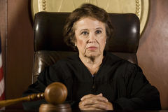 Thoughtful Female Judge Royalty Free Stock Images