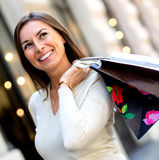 Thoughtful female shopper Royalty Free Stock Photo