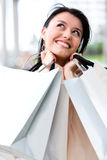 Thoughtful female shopper Stock Photography
