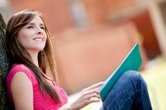 Thoughtful female student Royalty Free Stock Images
