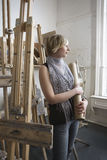 Thoughtful Female Student Amid Easels Royalty Free Stock Photos