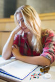 Thoughtful female student during class Stock Image