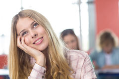 Thoughtful female student in classroom Royalty Free Stock Image