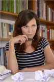 Thoughtful female student on desk Royalty Free Stock Photo