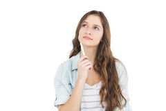 Thoughtful female student holding a chalk Royalty Free Stock Images