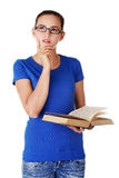 Thoughtful female student looking up Stock Photos
