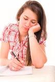 Thoughtful female student stock image