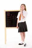 Thoughtful Female Student Wearing Uniform Next To Stock Images