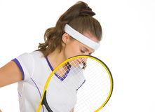 Thoughtful female tennis player holding racket Royalty Free Stock Photography