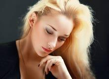 Thoughtful female Royalty Free Stock Image