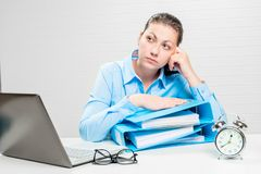 A thoughtful financial analyst in an office. With documents royalty free stock images