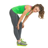 Thoughtful fitness young woman bent down Stock Photo