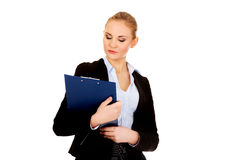 Thoughtful focused business woman holding clipboard Royalty Free Stock Photo