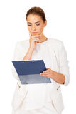 Thoughtful focused businesswoman reading her notes Royalty Free Stock Image