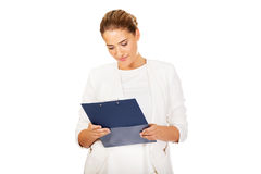 Thoughtful focused businesswoman reading her notes Royalty Free Stock Photo