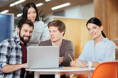 Thoughtful four colleagues discussing improvement royalty free stock image