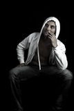 Thoughtful Gangsta. Thoughtful young Gangsta or hip hop guy royalty free stock photography