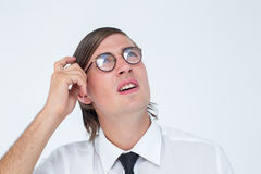 Thoughtful geeky businessman scratching his head Royalty Free Stock Images