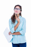 Thoughtful geeky hipster with a pen against her chin Stock Photography