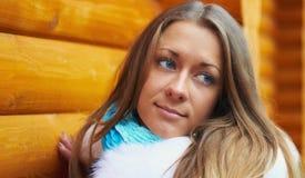Thoughtful girl. Near a wooden porch Stock Photos