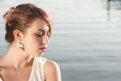 Thoughtful girl. Young girl in thoughtful exspression near the sea Stock Photo