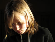 Thoughtful girl. Girl thinking or reading, could be sad or just focused Royalty Free Stock Photo