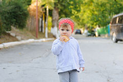 Thoughtful Girl with Biscuit Royalty Free Stock Images