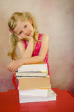 Thoughtful girl with books Stock Photos