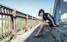 Thoughtful girl on a bridge Royalty Free Stock Photo