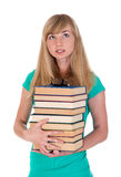Thoughtful girl with a bunch of books Royalty Free Stock Image