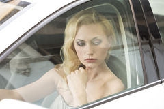 Thoughtful girl in a car Stock Photography
