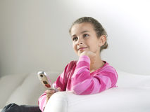 Thoughtful Girl With Cellphone Sitting On Sofa Royalty Free Stock Photos