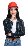 Thoughtful girl in construction helmet Royalty Free Stock Photos