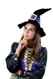 Thoughtful girl dressed in witch royalty free stock photography